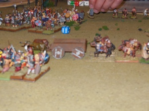 Kon's broken troops in background behind supply train retreating.