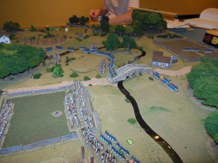 The fence line is captured by the Confederates and a much smaller Union unit falls back across the river