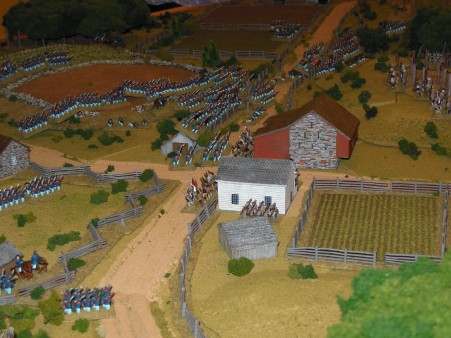 Union forces charge into the town and woods on the left