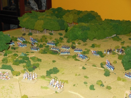 Union attacking the Confederate Left on the hill.