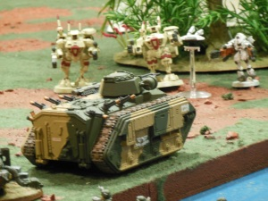 Imperial Guard APC about to get blasted.