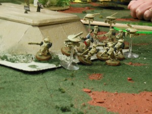 Tau units damaged and staying behind cover