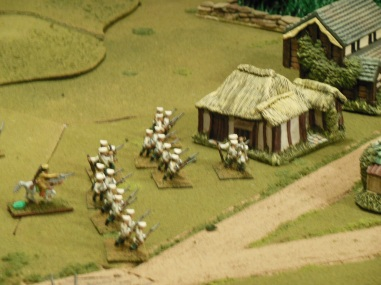Russian infantry have forced the Chinese back and advance on the village