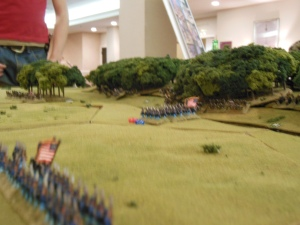 Union troops marching towards the objective and taking hits.
