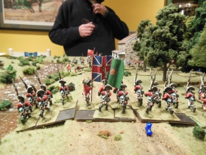 Disordered British troops facing the guns