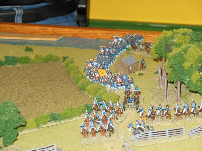 Union infantry and cavalry advance on rebel right flank